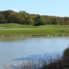 A view of a green over the water at Heritage Bluffs Public Golf Club