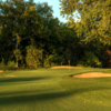 A view of a green protected by bunkers at Onion Creek Club