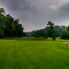 A view of a green protected by a bunker at Gokarna Forest Golf Resort