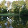 A view of a green with water coming into play at Philmont Country Club