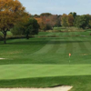 A view of a green protected by bunkers at Indian Spring Golf Club