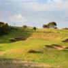 A view of a green protected by bunkers at The Dunes Golf Links