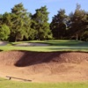 A view of green #8 protected by bunkers at Copt Heath Golf Club