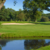 A view over the water of green #14 at Ladbrook Park Golf Club