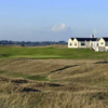 A view of a green and the clubhouse in the distance at Rye Golf Club