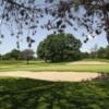 A view of a green surrounded by bunkers at Crestwood Country Club