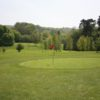 A sunny day view of greens at StarGolf Ullenwood