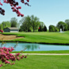 A spring day view over a pond at Fox Valley Golf Club
