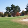 A fall day view of a green at Wyboo Golf Club