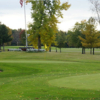 A view of the practice putting green and a green at Sheboygan Town & Country Golf Club
