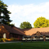 A view of a tee and the clubhouse at Waveland Golf Course