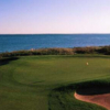 A view of a hole protected by sand traps at New Seabury Country Club