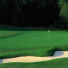 A view of a hole flanked by sand traps at Brier Creek Country Club