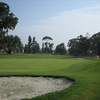 A view of green with bunker in foreground at  The Loma Club