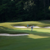 A view of a green flanked by bunkers at Keowee Key Golf & Country Club