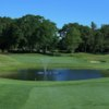 A view of a green with water coming into play at Sharon Country Club
