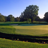 A sunny day view of a green at Country Club of Rochester