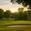 A view of a green protected by bunkers at Charlotte Country Club