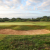 A view of a green protected by bunkers at Championship Course from Aldeburgh Golf Club