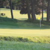 A sunny day view of a green at Porters Park Golf Club