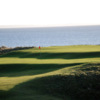 A view of the 16th green and the ocean in background at Golspie Golf Club