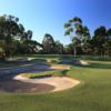 A view of the 7th green protected by tricky bunkers at Woodlands Golf Club