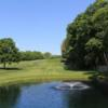 A sunny day view of a fairway at Glen Head Country Club