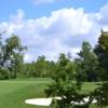 A sunny day view of a hole at Whispering Woods Golf Course