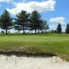 A view of a green protected by a bunker at Wemberly Hills Golf Course