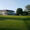 A view of a green and the clubhouse at Rockville Links Club