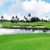 A view of a green with water and bunkers coming into play at Guam International Country Club