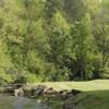 A view of a green with water coming into play at Bent Creek Golf Course