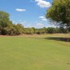 A sunny day view of a hole at Elephant Hills Resort Golf Course