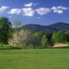 A spring day view of a hole at North Conway Country Club