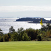A view of green #3 and water in the distance at North Haven Golf Club
