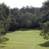 A sunny day view of a hole at Kodaikanal Golf Club