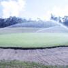 A view of a green beeing watered at Kodaikanal Golf Club