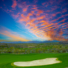 View of a bunker and green at Wickenburg Ranch Golf & Social Club