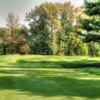 A view of a green flanked by bunkers at Medford Village Resort & Country Club