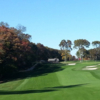 A fall day view of a fairway at Noyac Golf Club
