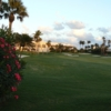 A view of the clubhouse and a well protected hole at Palm Beach Country Club