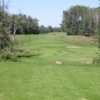 A view of a green protected by a bunker at Westlock Golf Club