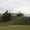 A view of hole #9 and the clubhouse in the distance at Chinook Valley Golf Course