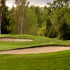 A view of a green protected by bunkers at Cordova Bay Golf Course