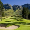 A view of a hole with mountains in background at Erinvale Golf Club
