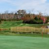 A splendid fall day view of a hole with water coming into play at Indian Lake Golf Course