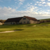 A view of a green and the clubhouse at Bridgend Golf Club