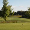 A view of a tee and a green in the distance at Pike Lake Golf and Country Club