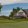 A view of the clubhouse and a hole at National Pines Golf Club
