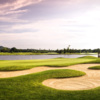 A view of a hole with water and bunkers coming into play at Crosswinds Golf and Country Club